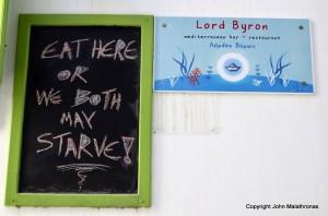 Sign by a taverna, Ios