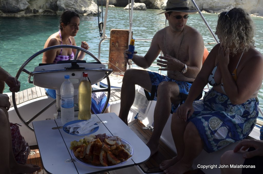 Eating on board sailing Milos