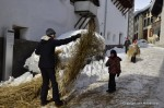 Hom Strom scuol Switzerland 		A woman gives straw to children