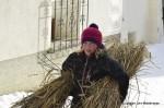 Hom Strom Children carry straw scuol Switzerland