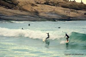 Surfers in Arpoador Rio de janeiro Brazil