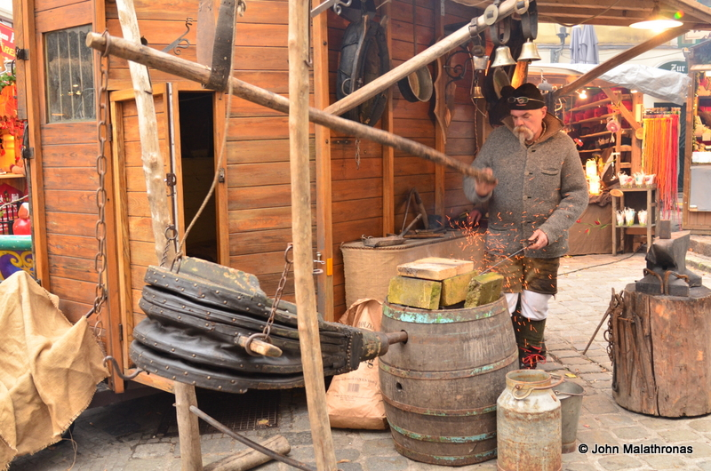 A blacksmith working in Spittelberg, Vienna Christmas market