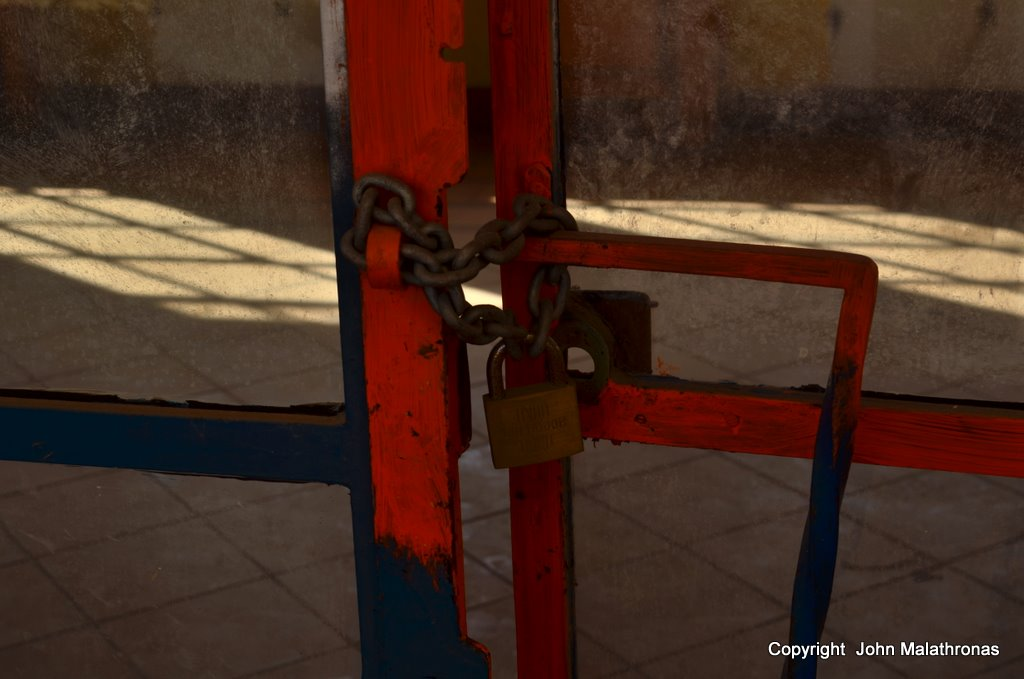 A lock at a train station door in Corinth