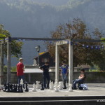 Teenagers play giant chess outside the Sherlock Holmes museum in Meiringen